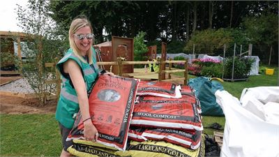 Jane Bingham receiving our compost for the Remember Me Garden at Tatton Flower Show 2017