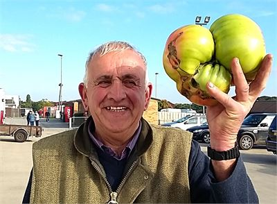 Ian Neale and his giant tomato